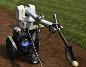 The one-armed, three-wheeled robot will throw out the ceremonial first pitch before the Wednesday, April 20, 2011, game between the Philadelphia Phillies and Milwaukee Brewers as part of Science Day festivities (image courtesy The Associated Press).