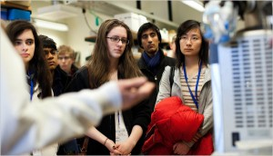 High school students, above, considering science-related majors, visiting an engineering lab at Yale [image courtesy The New York Times].