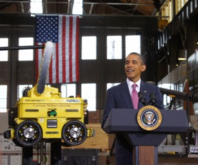 President Obama giving his speech.  Note the strategically placed robot in the background.
