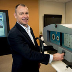 David Evans, Cisco's chief futurist, stands with a concept dashboard for a fully Internet-connected car [image courtesy Cisco via CACM].