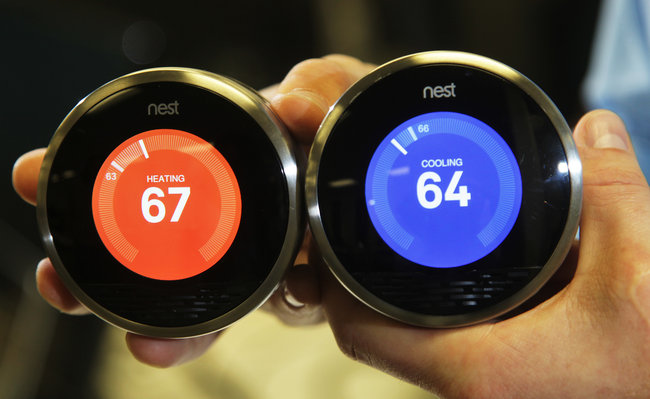 The Nest thermostat: the device's temperature is set by moving its outer ring [image courtesy Jim Wilson/The New York Times].