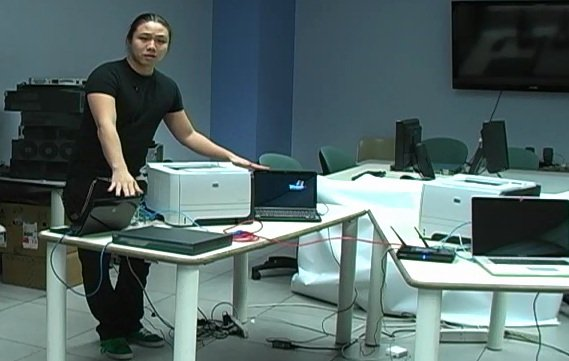 Columbia researcher Ang Cui explains how he was able to infect an HP printer with malicious code [image courtesy Columbia University via msnbc.com].