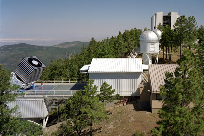 The Sloan Digital Sky Survey collects image data from an optical telescope in New Mexico [image courtesy Fermilab Visual Media Services via The New York Times].