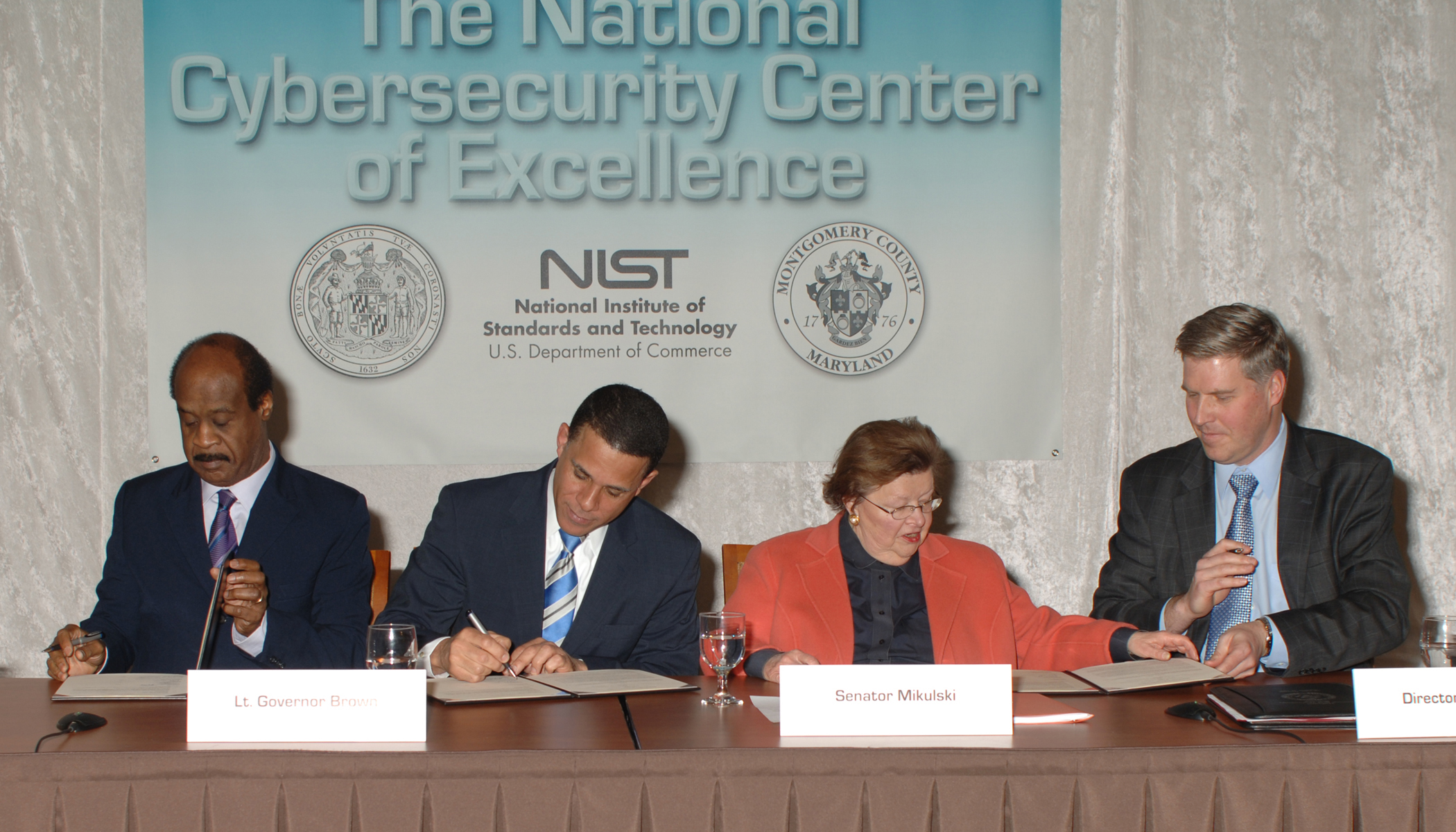 The State of Maryland and Montgomery County, Md., partner with NIST in the New National Cybersecurity Center of Excellence. At the Memorandum of Understanding Signing Feb. 21, from left to right, Montgomery County Executive Isiah Leggett, Maryland Lt. Governor Anthony Brown, U.S. Senator for Maryland Barbara Mikulski and Under Secretary of Commerce for Standards and Technology and NIST Director Patrick Gallagher [image courtesy NIST].