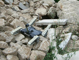 An urban search and rescue robot moves across a rubble pile in a recent NIST/DHS exercise [image courtesy NIST].