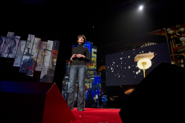 Regina Dugan delivering her TED talk in late February [image courtesy the TED Blog].