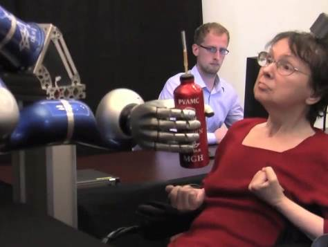 In a clinical trial, Cathy Hutchinson, who has been paralyzed for more than 14 years, used the BrainGate system to mentally control a robotic arm and reach for a drink [image courtesy The BrainGate Collaboration via msnbc.com].