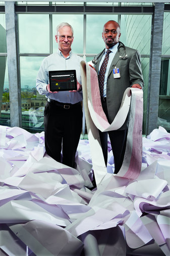 John Guttag, left, and Collin Stultz developed software that sifts discarded data from heart-monitoring machines looking for signs that patients are at high risk for a second heart attack [image courtesy Jason Grow/The Human Face of Big Data via The New York Times].