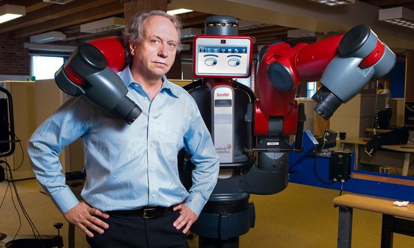 Rodney A. Brooks with Baxter, a robot he developed with an array of safety mechanisms and sensors [image courtesy Evan McGlinn for The New York Times].